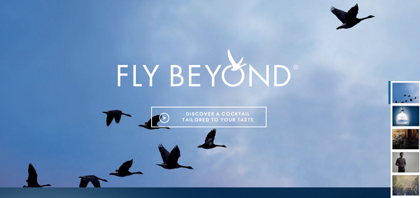 Eight black birds flying across a blue sky
